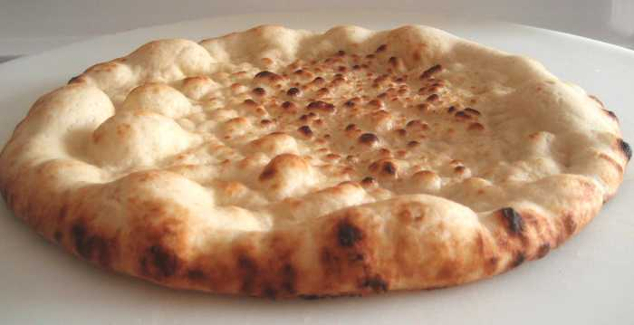 Uncooked pizza crusts